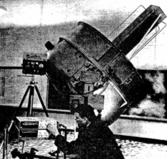 L. George Lawrence with one of his inventions - creator of the first laser engine.